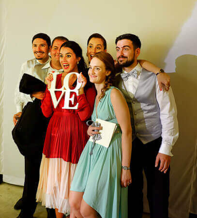 a grup posing in the photo booth