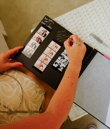 a guests signs the wedding album